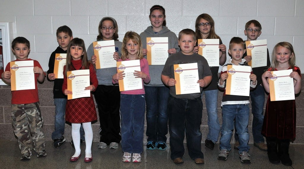 BOMBER COURTESY CLUB … Students at Edon Northwest Local Schools selected for membership into the Bomber Courtesy Club for December 2012 were, front row, from left, Collin Sprow, Kally Randall Taylor Pack, Clayton Dulle, Westen Hickman, Darion Deck and back row, Zack Sprow, Ashley Kaylor, Jordan Runyan, Karlie Scher and Dayton Cope.  Not pictured ~ Derango Sheets.  Each student received a special certificate and coupons good for a cookie and ice cream treat from the schools cafeteria.
