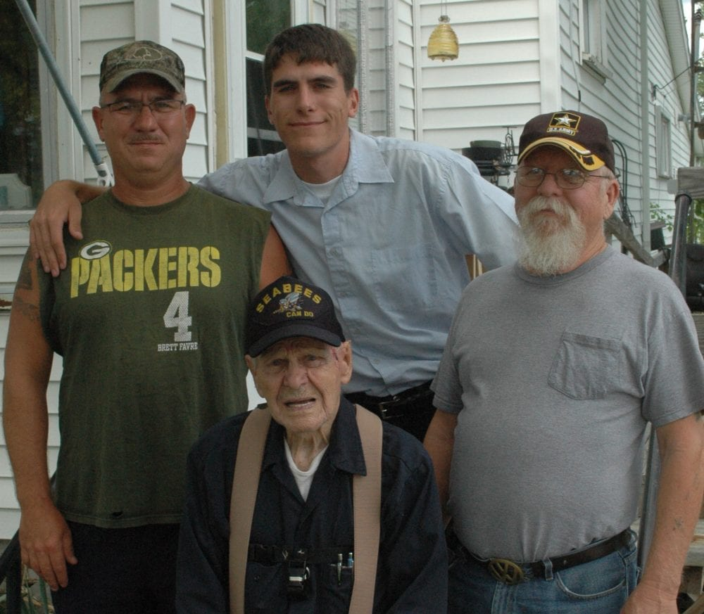 Ross Rummel was joined for the interview with his son, Raymond Rummel, a nine-year Army veteran; grandson Alan Bumpus, a 15-year Army veteran and great-grandson Michael Bumpus, a four-year veteran of the Marines, both of Hillsdale, Mich.